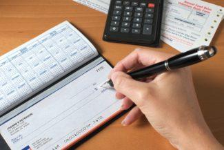 Customer writing checks on different checking accounts